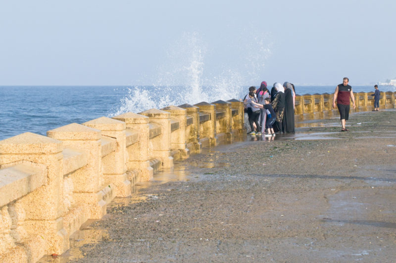 People enjoying the waves at Jeddah Corniche by Noel Cabacungan
